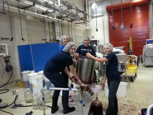Denise Gardener pressing wine with students at Penn State